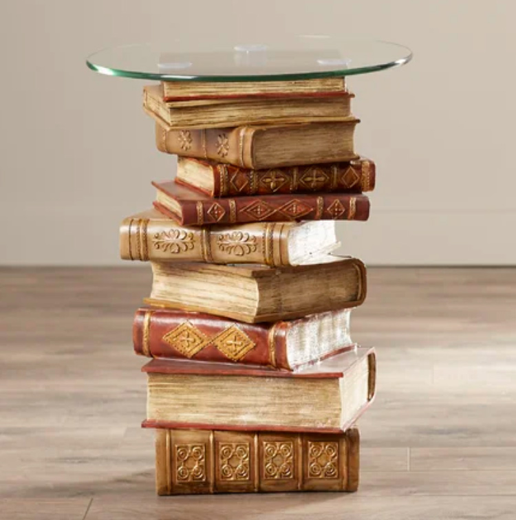 stacked books as base of side table